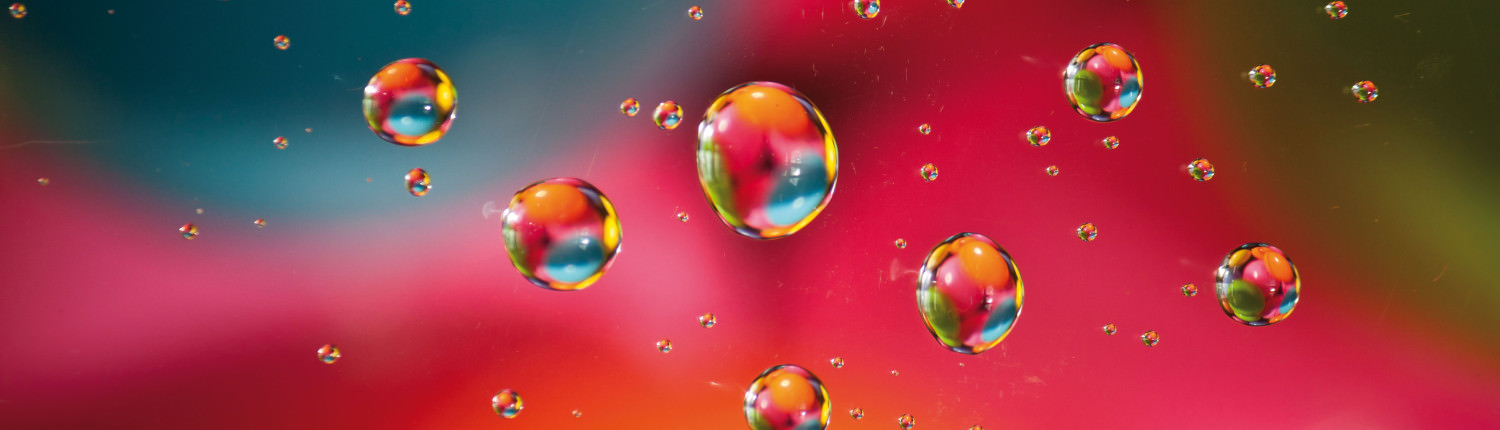 Abstract water drop on colourful ball